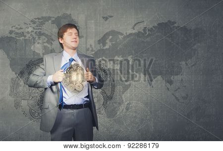 Young businessman in suit opening his chest and acting like super hero