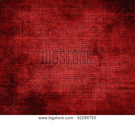 Grunge background of crimson red burlap texture