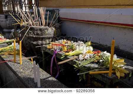 Buddhist people put the flower ,joss stick ,candle and lotus on the table after pray for pagoda Tak