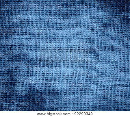 Grunge background of cyan azure burlap texture
