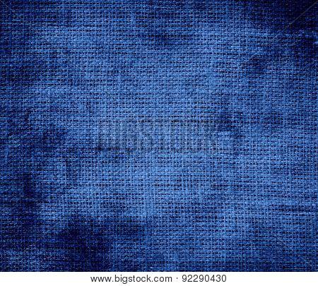 Grunge background of cyan cobalt blue burlap texture