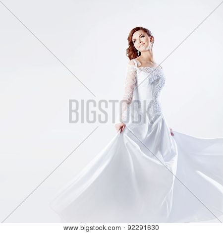 Beautiful bride in wedding dress, white background, square