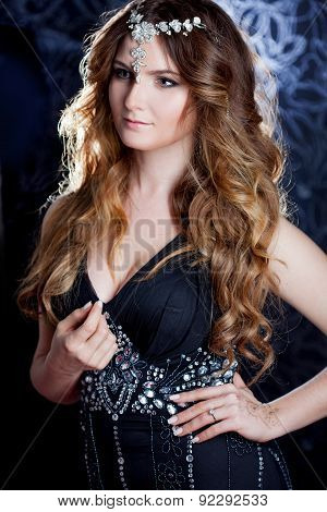 Beautiful Girl  With Long Brown Curled Hair, Dark Background, Vertical Cropping
