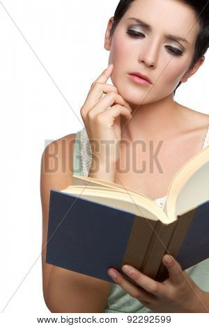 Thoughtful young woman reading book