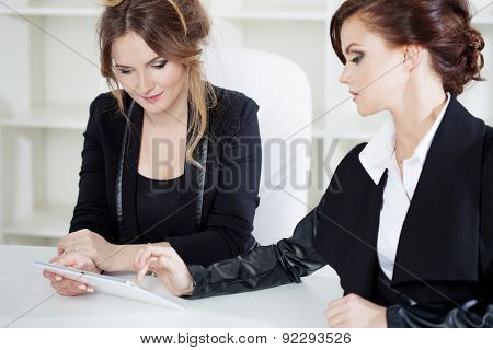 Young Buisnesswoman Showing Something To Her Colleague, On The Laptop. Work In Office