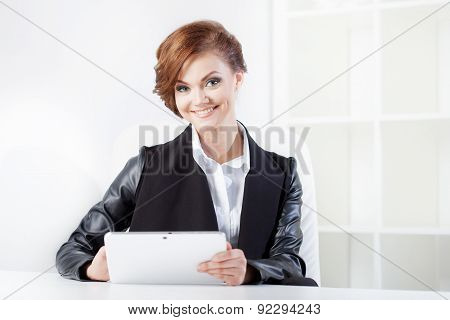 Young Businesswoman With Tablet In Hand Looking Confident And Smiling