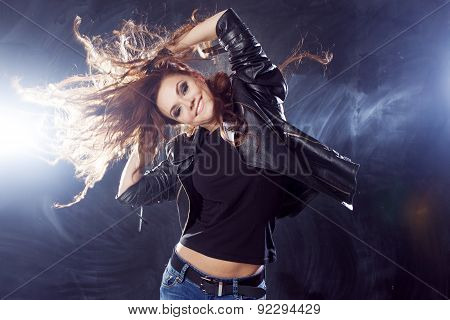 Smiling Young Woman Dancing, Hair Flying