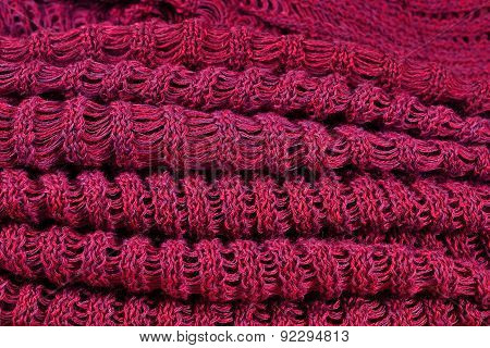 Stack Of Red Melange Openwork Knitted Fabric
