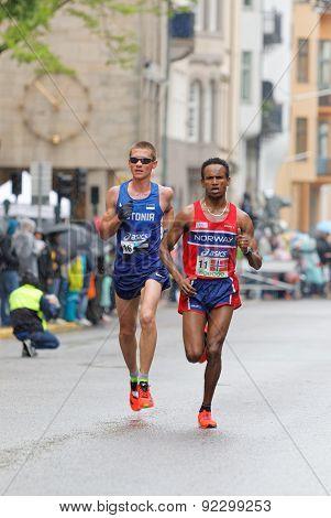 Dadafo Dhaqabi Tesama And Kaupo Sasmin Running