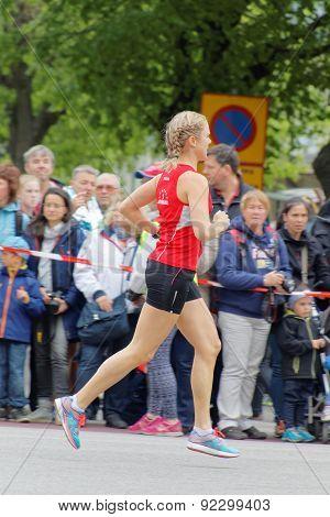 Blond Girl Running In Red Shirt