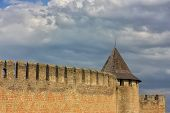 stock photo of wall cloud  - wall and tower ancient castle in Khotyn - JPG