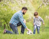 foto of football pitch  - Young father with his little son having fun on football pitch - JPG