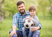 picture of football pitch  - Young father with his little son having fun on football pitch - JPG