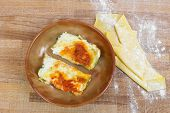 picture of lasagna  - lasagna with tomato sauce inside earthenware bowl - JPG