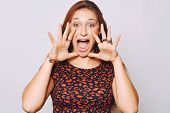pic of screaming  - Beautiful young woman shouting and screaming isolated over plain background - JPG