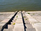 picture of descending  - Concrete grey stairs descend into the water of the river Danube - JPG