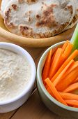 picture of crudites  - Close up of bowls containing hummus dip - JPG