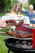 picture of frazzled  - Closeup of barbecue with grilled sausages and shishkebabs - JPG