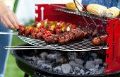 image of frazzled  - Sausages shiskebabs and corns lying on the grill - JPG