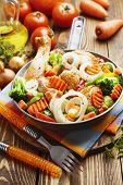 stock photo of fried chicken  - Fried chicken with vegetables in the frying pan - JPG