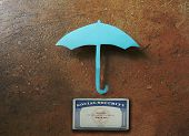 picture of social-security  - Paper umbrella over a Social Security card  - JPG