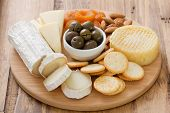 picture of fruit platter  - cheese with olives dry fruits and cookies - JPG