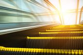 picture of escalator  - Blurry modern escalator at sunny day - JPG