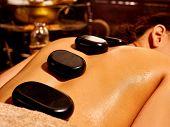 picture of panchakarma  - Young woman having Ayurveda stone massage - JPG