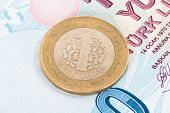 picture of turkish lira  - One Turkish lira coin on one hundred banknote - JPG