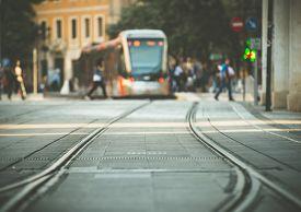 stock photo of tram  - tram tracks and a tram on the street of Munich - JPG