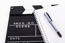 stock photo of clapper board  - Black cinema clapper board and notebook for scenario with pen isolated on white background - JPG