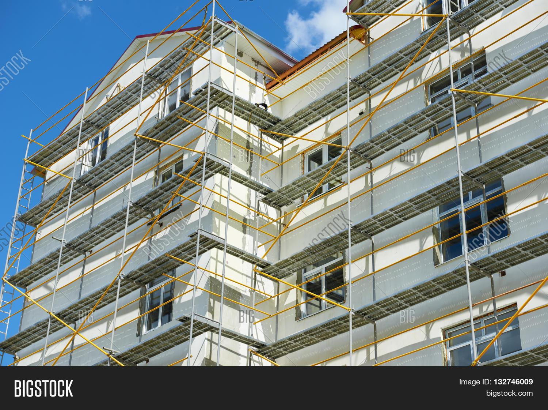 Apartment Building Construction scaffolding near a house under construction for external plaster