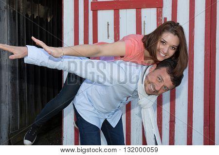Man Giving His Pretty Girlfriend A Piggy Back