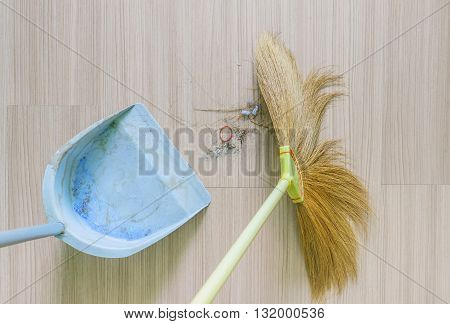 top view of a broom and Dustpan old with dust in living roomselect focus