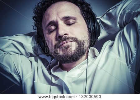 classical music, man with intense expression, white shirt