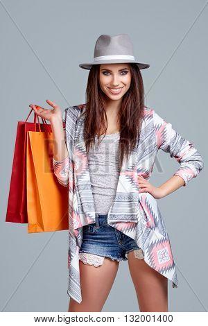 Fashion woman with shopping bags. Studio shoot