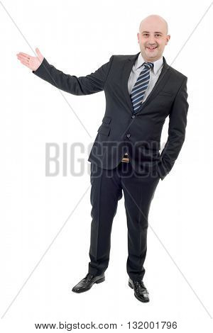 Handsome businessman with arm out in a welcoming gesture, isolated on white