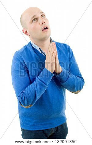 Portrait of a religious expressive man praying in studio on white isolated background