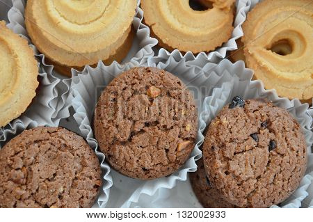 chocolate cookie on paper tray in box