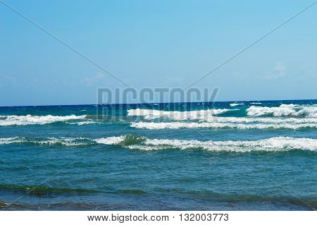 seascape ashore from the rolling blue waves