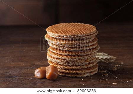 Waffles with caramel on wood