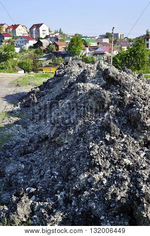 The soil is dumped in a pile during construction work