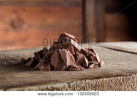 Pieces of milk Chocolate on wood