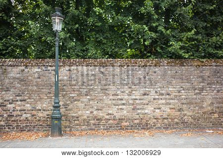 Lamp post street on brick wall background