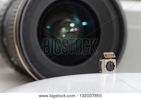 Two lenses / The lens of the camera and a smartphone