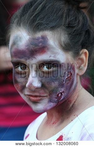 BELGRADE,SERBIA - OCTOBER 21: Woman with mask poses in Zombie walk within reeling of the  Festival  of Serbian fiction movies October 21, 2012 in Belgrade,Serbia
