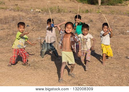MRAUK-U MYANMAR - JANUARY 26 2016: Unidentified poor but healthy children group portrait outdoors