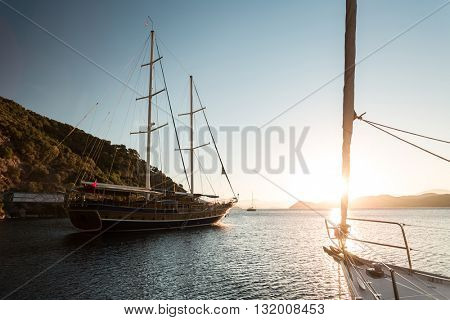 Traditional sail boat anchored in a bay of Skopea Limani, Turkey