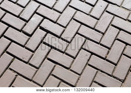 Dark gray brick pavers. Background. textured texture