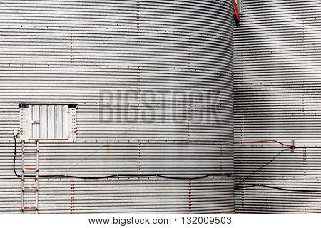 Old agricultural grain elevator storage bins detail.